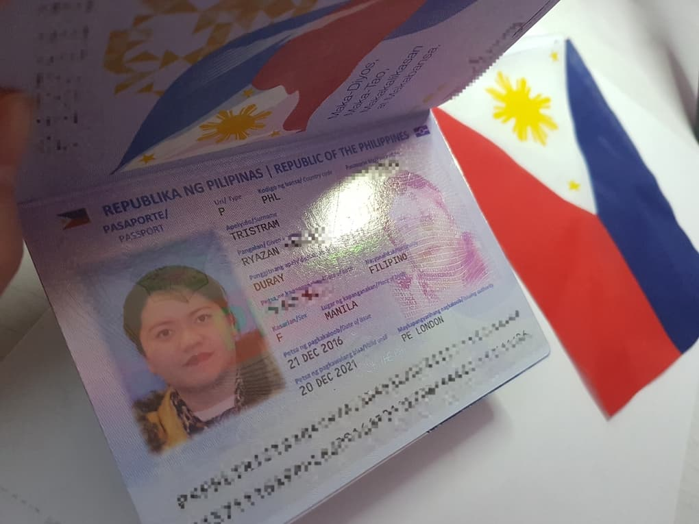 inside the philippine passport with blue background photo